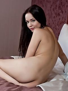 Hot brunette in hotel room