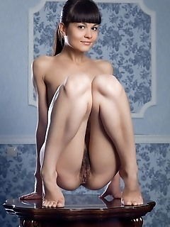 Tiny charmer with girlish amateur allure and nubile assets.
