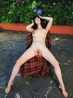Malena malena poses outdoors as she bares her delectable body.