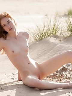 Ginger beauty sunbathing