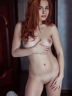 Nicole la cray redhead nicole la cray displays her luscious body and sweet pussy on the bed.