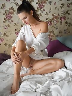 Jasmine jazz jasmine jazz sensually poses on the bed baring her sexy, slender body.