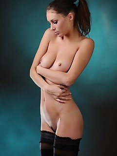 Yarina a metart top model yarina a in a sequin bustier, blackj thigh-high stockings, and black stilettos