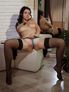 """Anatali """"a long black cardigan, black thigh-high stockings, and a blue cheeky panty showcases anatalis long and slender physique"""""""
