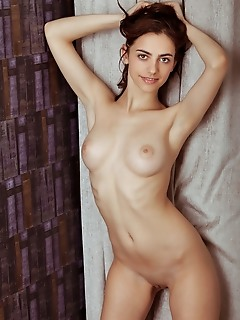 Mercedes mercedes bares her slender body with beautiful breasts and smooth pussy as she poses on the   chair.