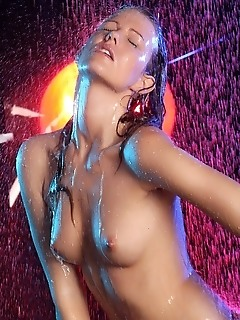 Bathing hottie with erotic, sensual poses under the shower.