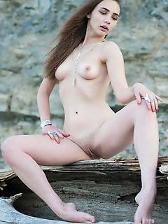 Cute model on rocks