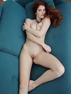 Adel c redhead adel c shows off her smoking hot body as she strips on the couch.