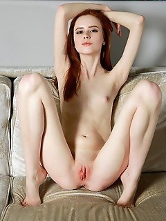 Bella milano redhead bella milano bares her creamy, petite body and pink pussy on the couch.