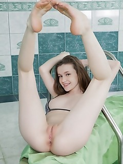 Emily bloom emily bloom displays her flexible body as flaunts her pink pussy.