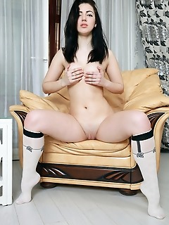 Sivilla sivilla strips on the sofa baring her pink nipples and pink pussy.