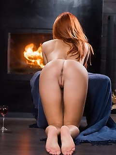 Michelle h michelle h strips by the fireplace as she flaunts her smoking hot body.