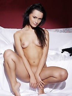 Enticing vixen with sexy black hair, gorgeous body, and hypnotic gaze.