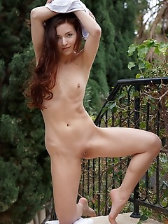 Berenice berenice stpreads her legs wide open as she displays her sweet pussy outdoors.