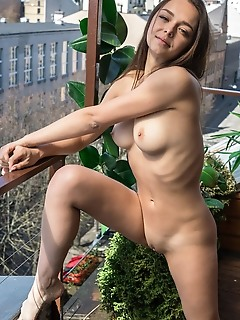 Slava slava bares her slender body with beautiful tits as she waters the plants.