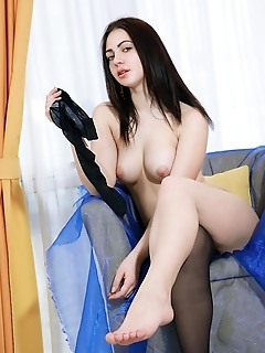 Sivilla sivilla strip her sexy lingerie baring her delectable body on the chair.