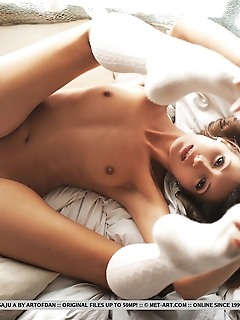 Saju a saju a shows off her tight body with erect nipples and smooth pussy as she poses on the bed.