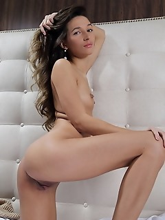Kenya kenya strips on the bed as she flaunts her tight body and sweet pussy.