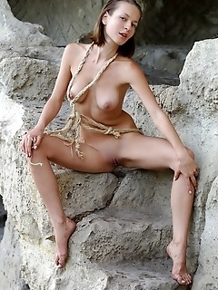 An erotic brunette with a fetish for ropes and the outdoor.