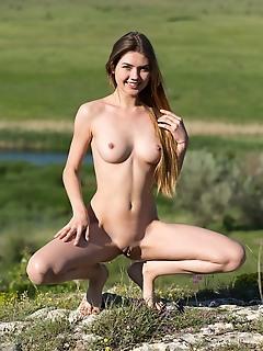 Georgia top model georgia strips on the grassy field baring her sexy body.