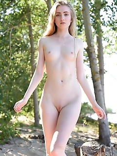 Lena flora youthful lena flora poses on the sand baring her creamy, nubile body.
