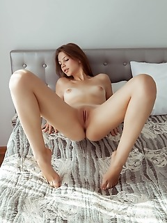 Emma sweet emma sweet sensually poses on the bed as she flaunts her slender body.