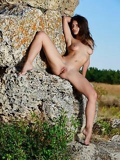 Yasmina yasmina strips outdoors baring her sexy, tight body.