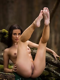 Jasmine jazz jasmine jazz strips in the forest as she shows off her sexy, tigh body.