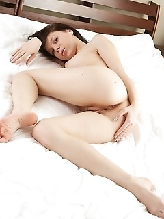 Pale, nubile skin, wide open poses, erotic photos.