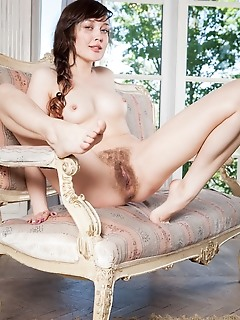 Ulia ulia bares her perky tits and unshaven pussy in front of the camera.