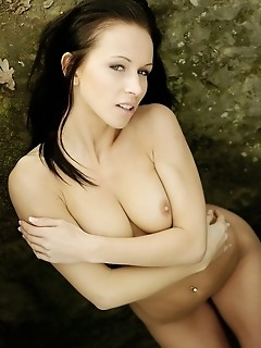 Exotic brunette with athletic body, perky nipples, and large rump.
