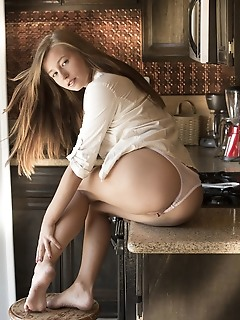 Carolina sweets carolina sweets strips in the kitchen as she flaunts her delectable body.