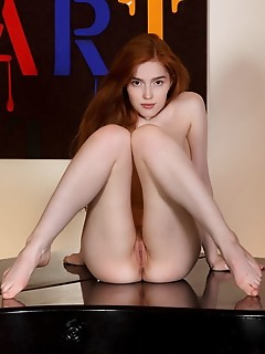 Jia lissa redhead jia lissa flaunts her yummy body and sweet pussy on the table.