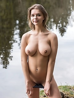 Yelena yelena strips by the river baring her curvy hips and big tits.