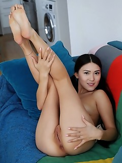 Kimiko asian beauty kimiko displays her sexy, slender body and smooth pussy on the couch.