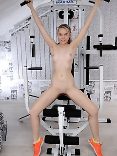 Eva jude eva jude strips in the gym as she poses on the exercise equipment.
