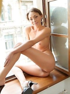 Refreshingly cute and petite model with small but perky breasts and nubile physique.