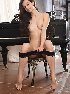Starlet starlet strips by the piano as she bares her sexy body, tight ass and sexy legs.