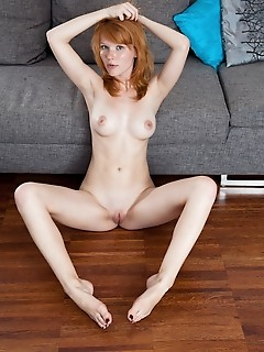 Mia sollis redhead mia sollis shows off her amazing body as she strips on the couch.