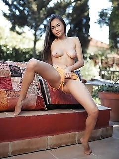 Li moon li moon bares her topless body as she strips her cut off shorts.