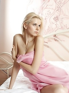 Mesmerizing vision of stunning blonde with long, slender physique and pink, luscious assets.