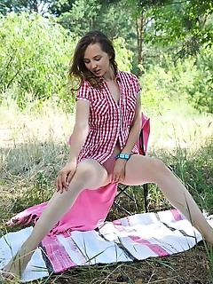 Ava ava bares her delectable, nubile body as she strips outdoors.