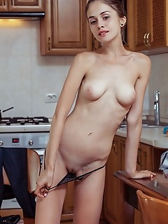 Maria espen maria espen strips in the kitchen as she displays her small pussy.
