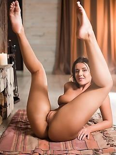 Sybil a sybil a sensually strips as she displays her luscious body.