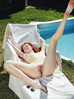 Adel c redhead adel c strips by the pool as she displays her pink nipples and yummy pussy.