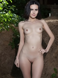 Mona alluring mona strips outdoors as she bares her sexy body and smooth pussy.