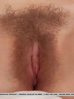 Briana briana bares her sexy, nubile body and hairy pussy on the bed.