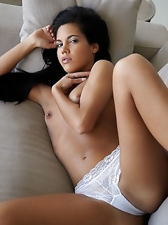 Apolonia apolonia flaunts her smoking hot body and smooth pussy on the couch.