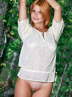 Violla a redhead violla a shows off her meaty ass and smooth twat outdoors.