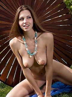 Vibrant and enthusiastic brunette in erotic, artistic poses.